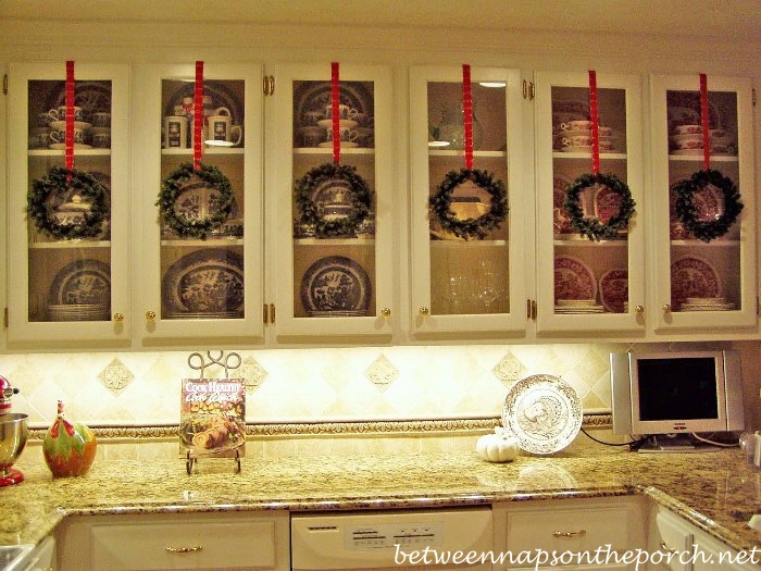 Decorating with Wreaths on Cabinets