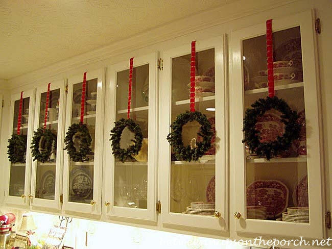 Faux Wreaths on Kitchen Cabinets