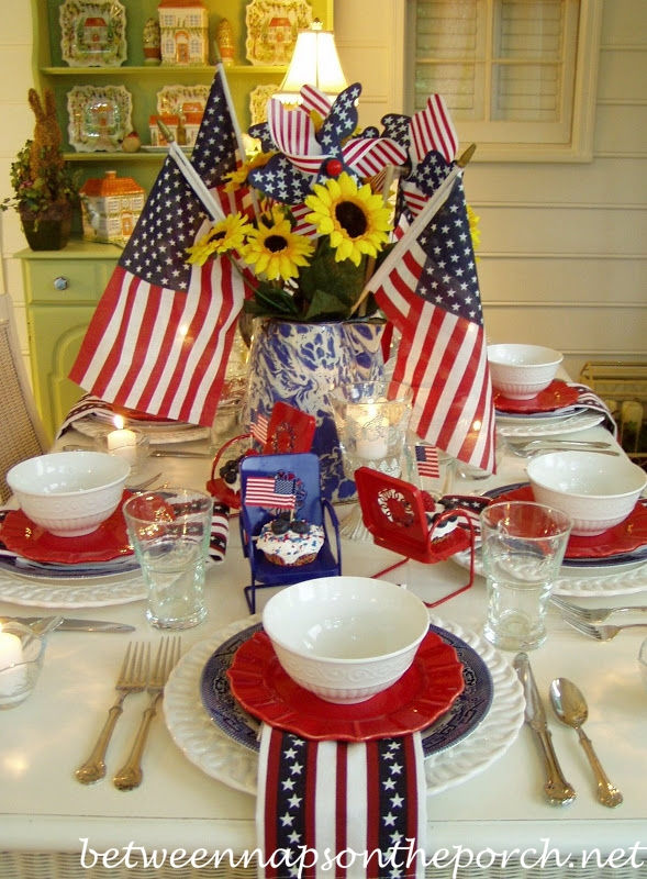 I've been working on a patriotic themed tablescape in my head for weeks now...couldn't quite pull it together in time for Memorial Day. But, there was no way I was letting the 4th of July get by without celebrating the Red, White and Blue!