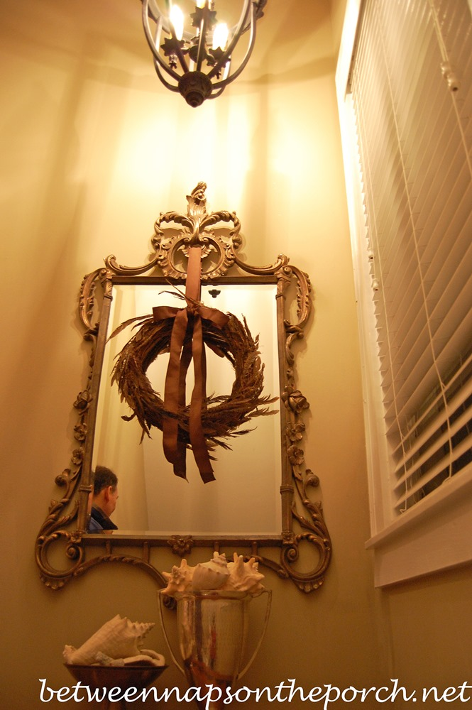 Mirror Decorated with a Wreath for Christmas