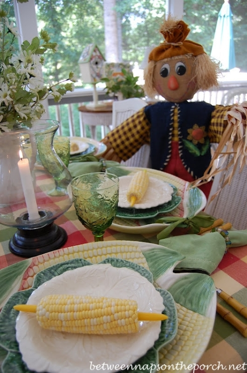 Summer Table Setting with Corn Chargers and Plaid Tablecloth