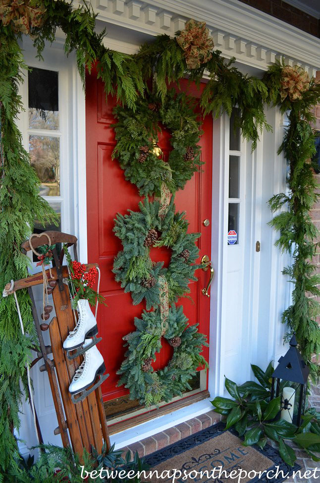 Christmas Porch Decorated with Cedar Garland and Sled, Ice Skates