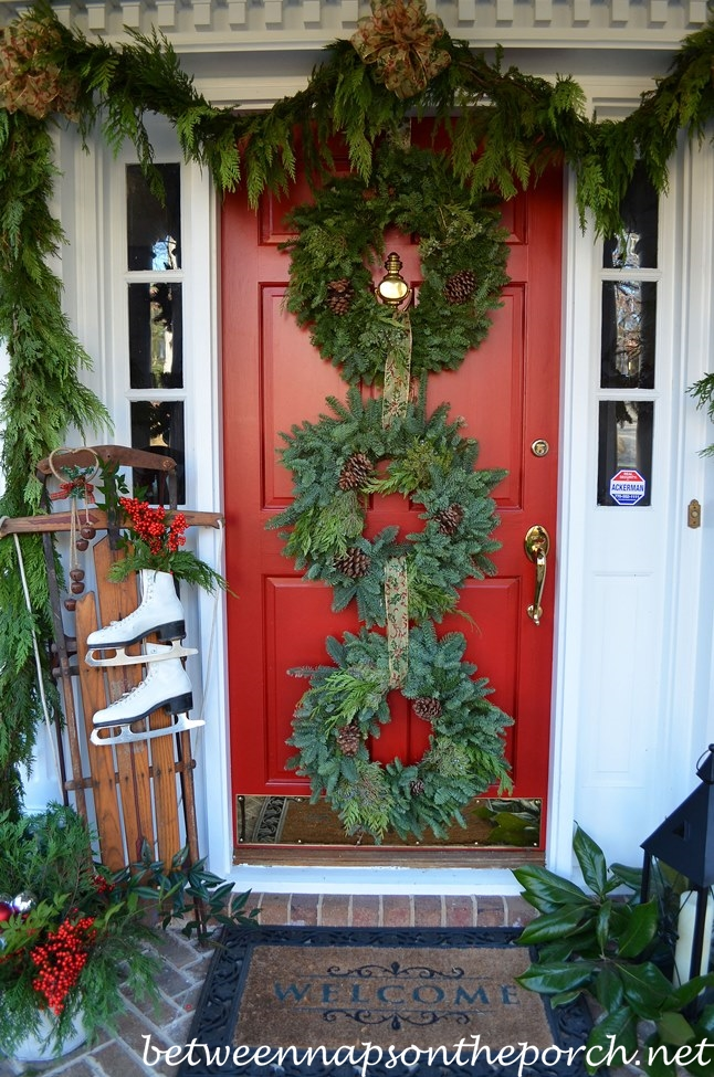 Red Christmas Front Door Decorated with Triple (3) Wreaths