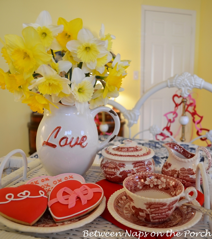 Daffodils in Love Pitcher With Heart Cookies On Valentine's Day