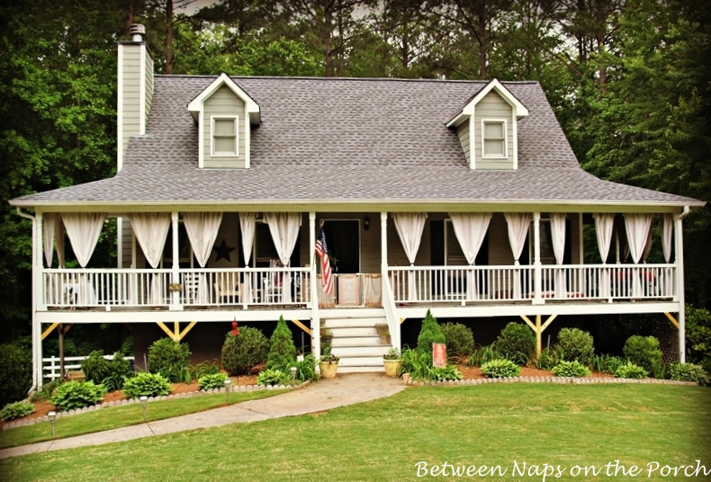Drop cloth curtains for a porch add privacy and sun control for Homes with porches all the way around
