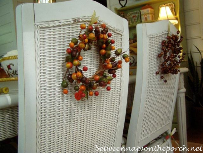 Back of Chairs Decorated with Wreaths for Fall