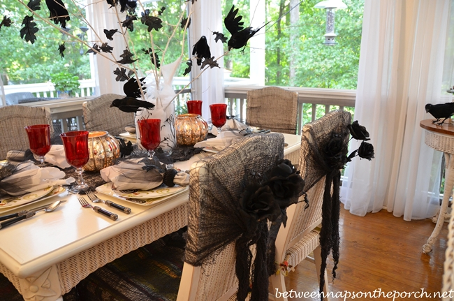 Chair Backs Decorated with Black Roses and Spiders for Halloween