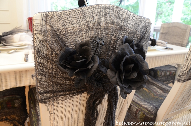 Chair Backs Decorated with Black Roses and Spiders for Halloween Table