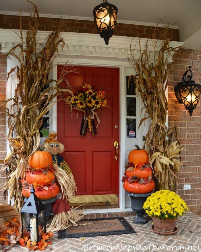 Halloween Porch With Pumpkin Topiaries_wm