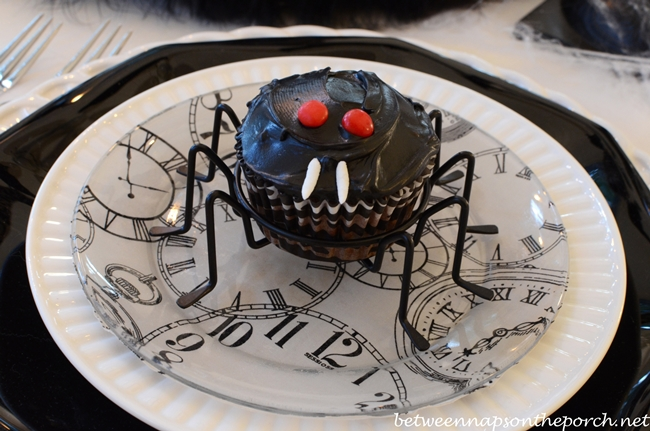 Spider Cupcake with Marshmallows Fangs and Eyes Made from Red Hot