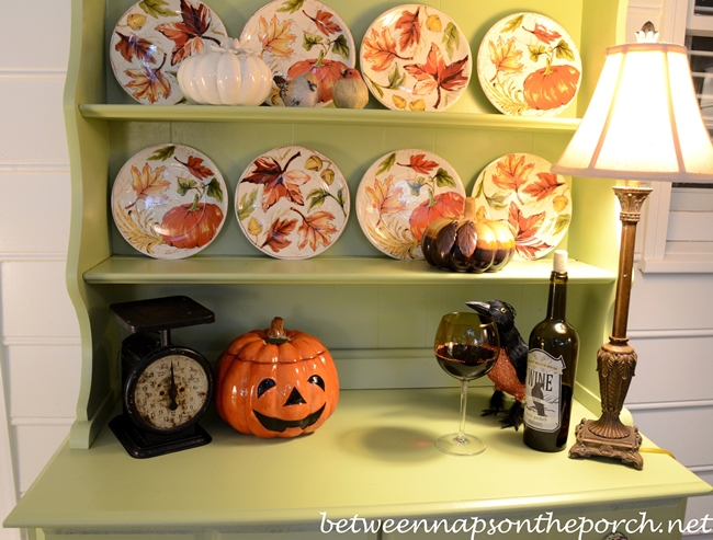 Hutch on Screened-in Porch, Decorated for Halloween with Fall Plates