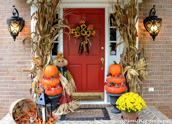 Porch Decorated for Fall with Pumpkin Topiaries