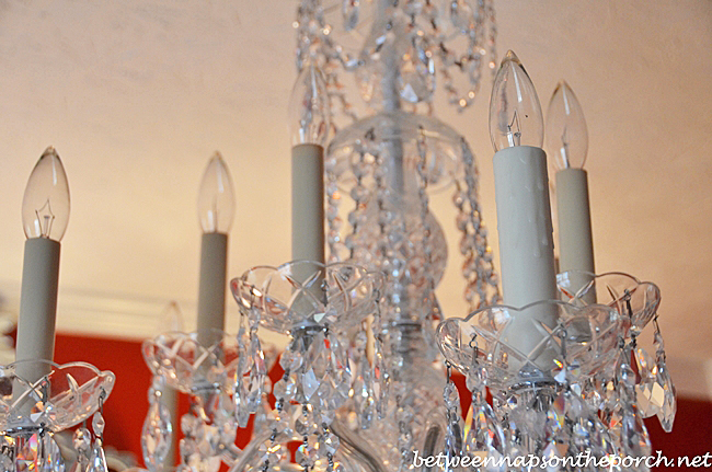 Transform an ordinary chandelier with resin candle covers and silk oh aloadofball Choice Image
