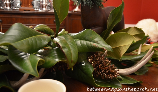 Centerpiece with Magnolia Leaves, Deer and Pine Cones