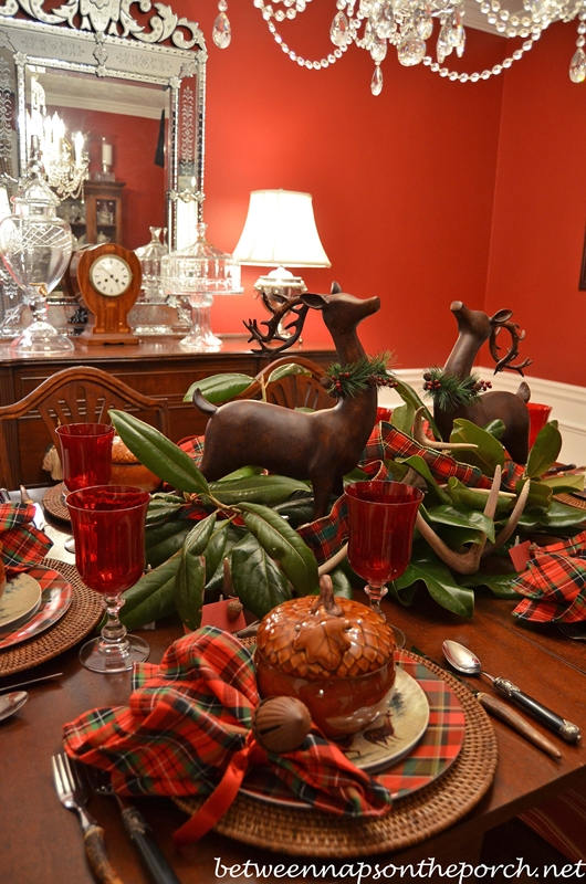 A christmas party tablescape table setting with deer and
