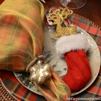 Christmas Tablescape Place Setting with Plaid Plates and Plaid Napkins