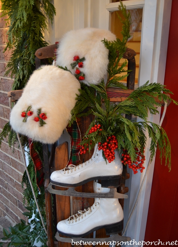 Porch Decorated for Christmas with Garland, Sled, Ice Skates, Muff and Snowflake Wreath 08