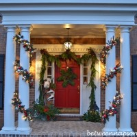 Decorating the Porch with Cedar Garland and a Snowflake Wreath