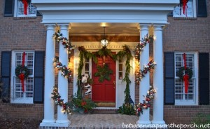 Decorating-the-Porch-for-Christmas-with-Garland-Sled-Ice-Skates-Muff-and-Snowflake-Wreath