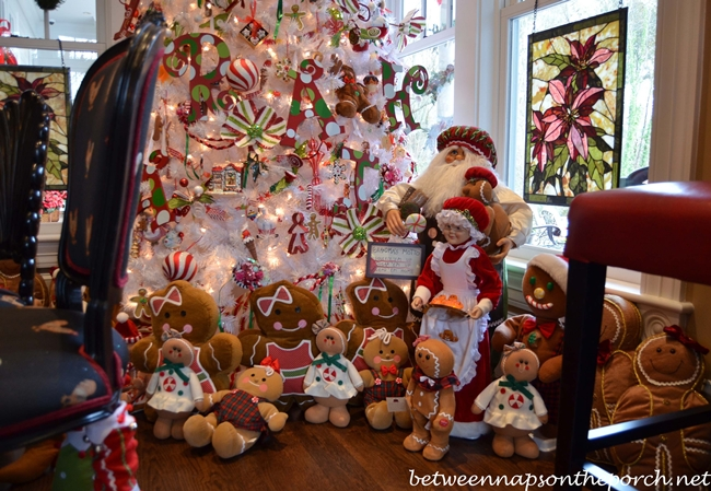 White Candy Themed Christmas Tree Surrounded by Gingerbread Men