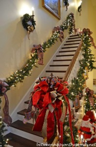 Stairway Decorated with Lit Garland and Ribbon for Christmas