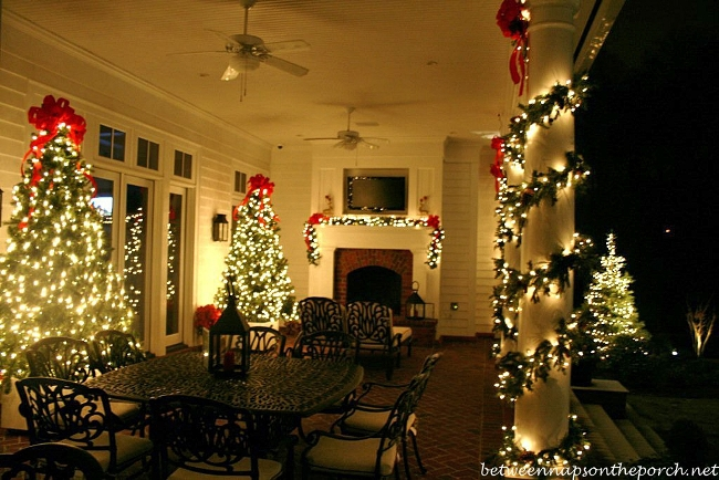 Outdoor Entertaining Veranda with Fireplace and Christmas Trees