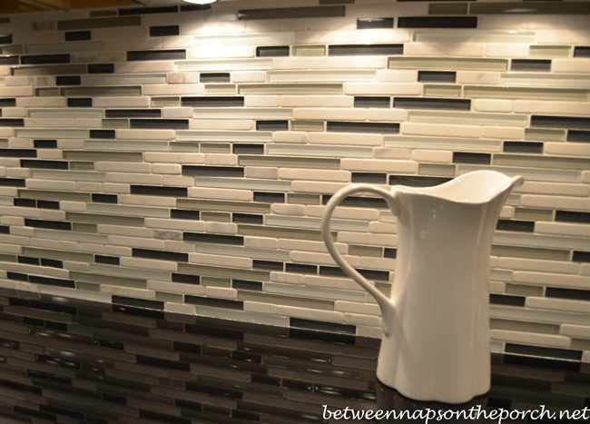 Kitchen with Marble Top Island and Glass Tile Backsplash for Basement Terrace Level