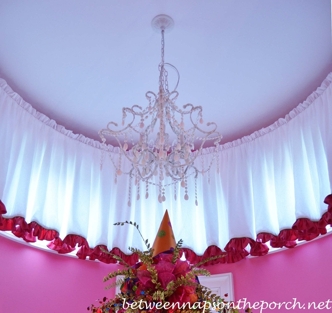 Shades of Light Chandelier in Pink Girl's Bedroom with Pottery Barn Beds