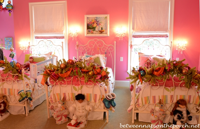 End of Bed (Footboard) Decorated in Pink Girl's Bedroom with Pottery Barn Beds and Shades of Light Chandelier and Sconces
