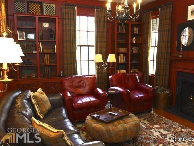 Study Library with Red Bookcases, Red Walls, Leather Furniture and Plaid Draperies