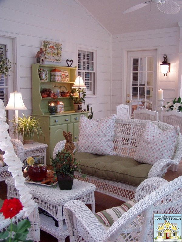 Screened Porch with White Wicker Furniture