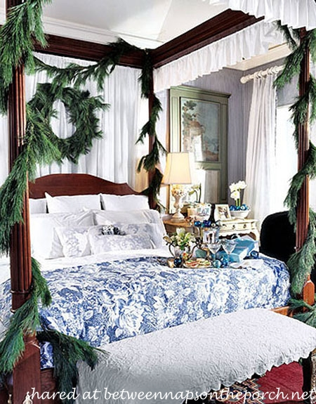 4-Poster Bed Drapped with Pine Garland_wm
