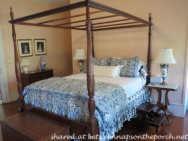 A Blue And White Bedroom And Bath