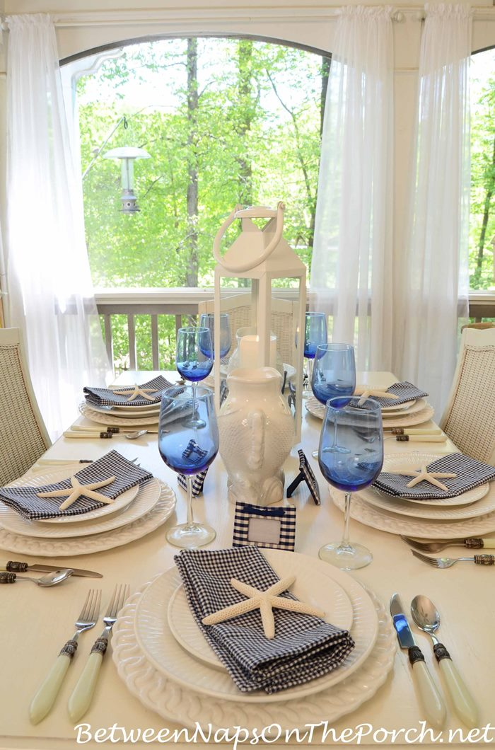Blue and White Table With Check Place Card Holders and Napkins