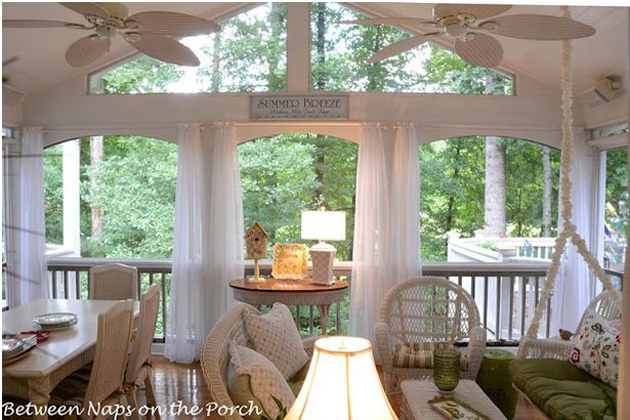Screened Porch with Sheer Curtains and White Wicker Furniture