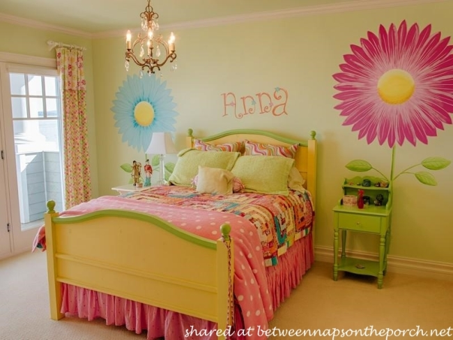 Child's Bedroom in Bright Colors with Green Walls and Floral Motif Design on Walls