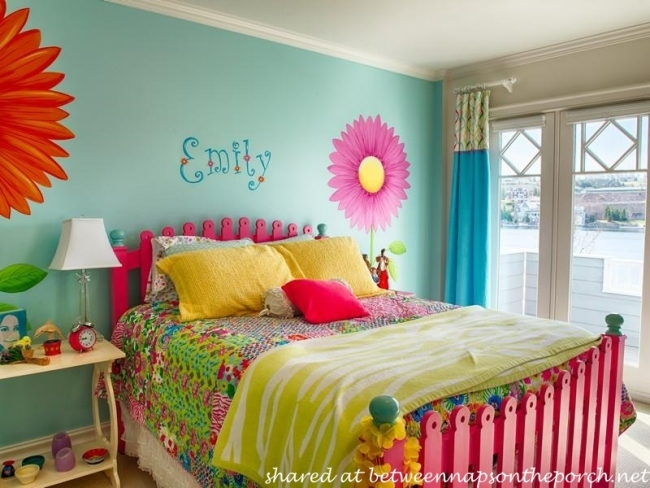 Child's Bedroom in Bright Colors with Blue Walls and Floral Motif Design on Walls