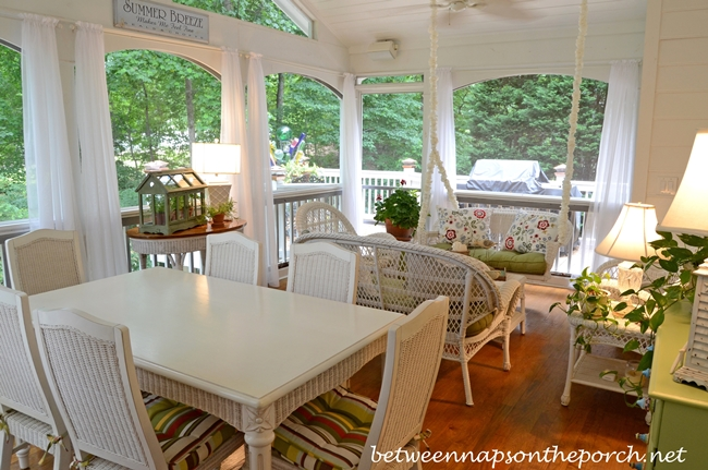 Screened-In Porch with White Wicker Furniture