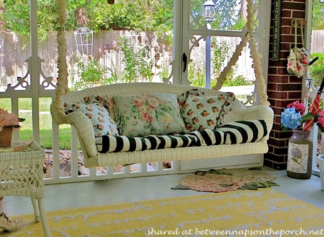 decorate a porch in victorian resort style with white wicker and striped cushions us227. Black Bedroom Furniture Sets. Home Design Ideas