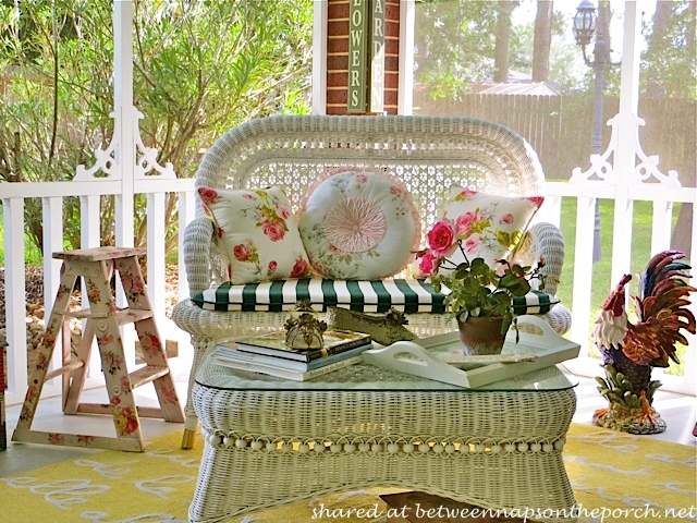 Victorian Screened Porch with white wicker settee