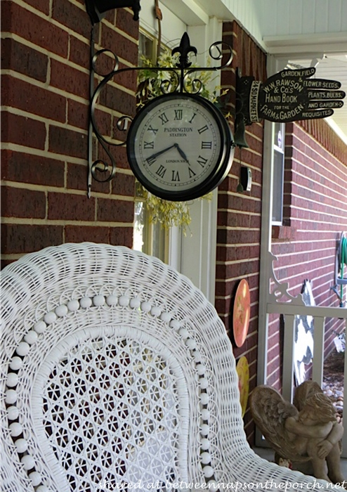 Victorian Screened Porch with Clock Hanging from Porch Wall