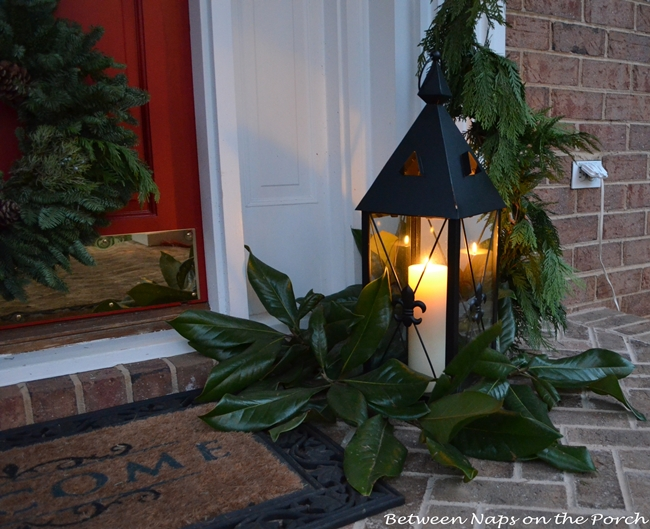 Lantern-on-Front-Porch-with-Magnolia-Leaves