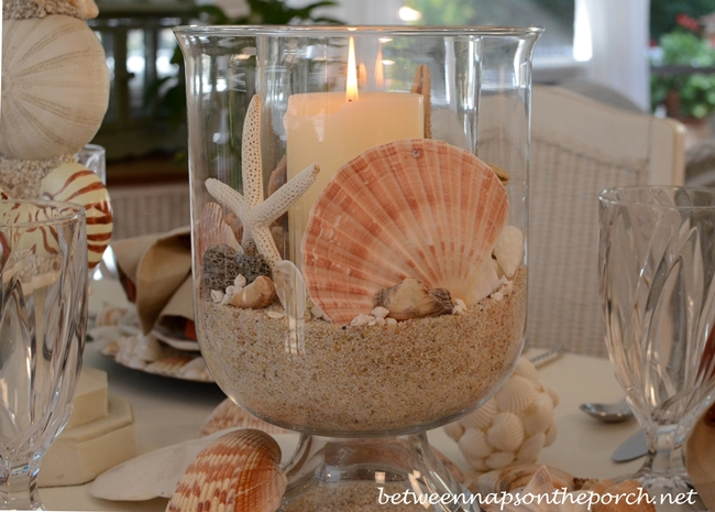 Beach themed table setting with crab lobster plates and