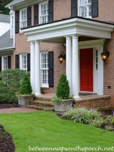 Boxwood Topiaries in Lattice Planters with Annuals for Traditional Landscape