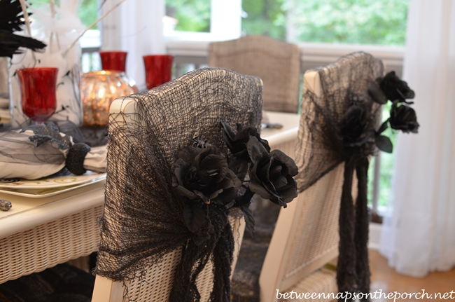 Chair-Backs-Decorated-for-Halloween with Black Roses