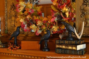 Fall Mantel Decorated with Wreath and Blackbirds_wm