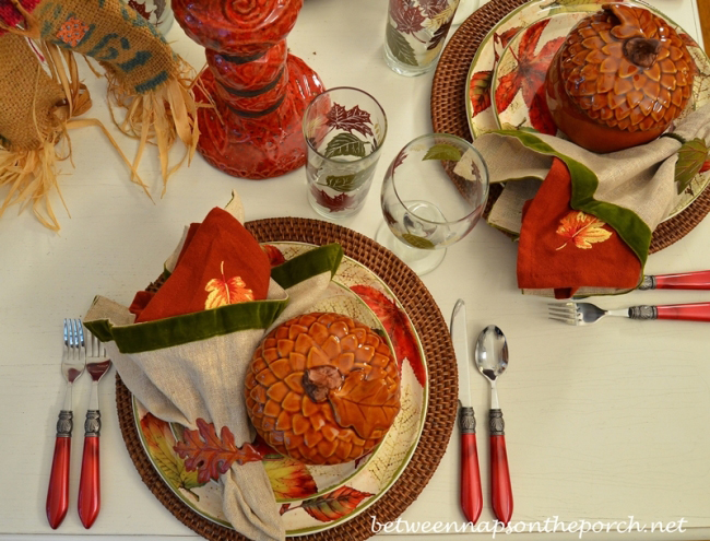 Fall Table Setting with Leaf Themed Dishware and Napkins