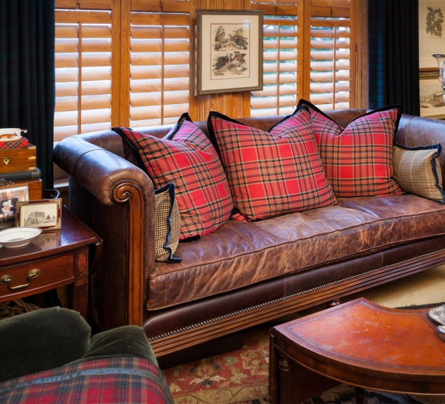 Leather Sofa with Plaid Pillows