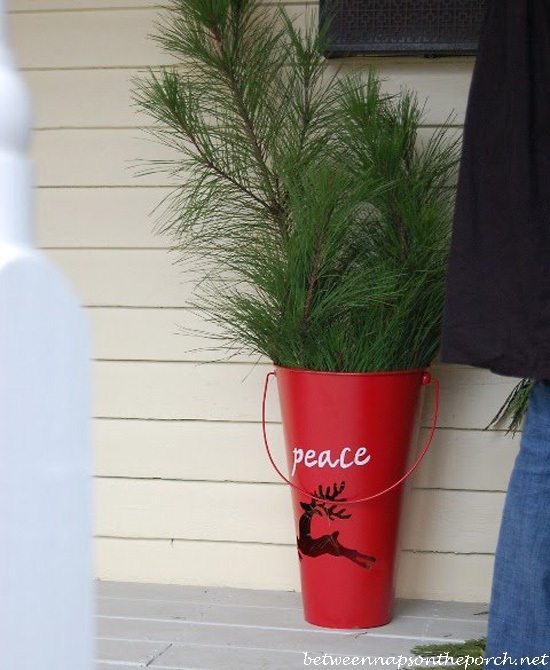 Red Bucket Container with Greenery for Christmas_wm