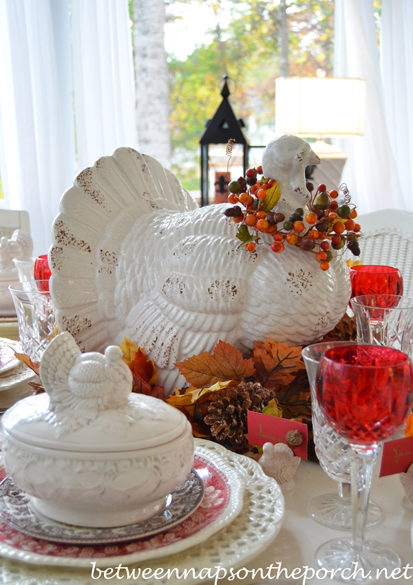 A fall thanksgiving table setting and tablescape with